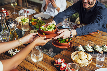 People Holding Bowl With Salad